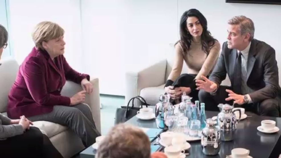 George and Amal Clooney talk migrant crisis with German Chancellor